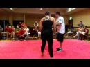 Girl taping a boy BJJ