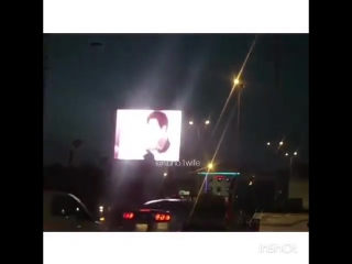 In celebration of suho's birthday, iraqi fans displayed a video ad on one of the streets in iraq!