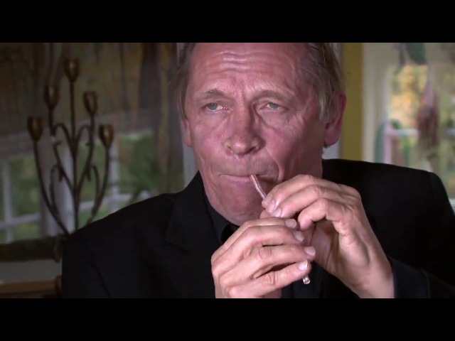 Peter Bastian is playing a straw like a double reed instrument