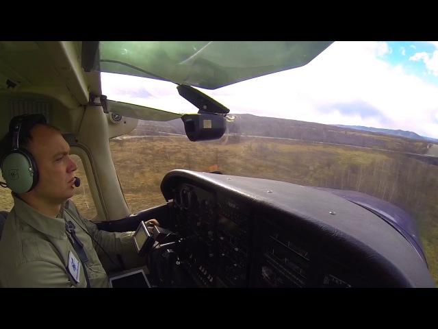 Cessna 182P landing at Mogocha (UIAM) on a bit windy day/Посадка в Могоче в немного ветреный день