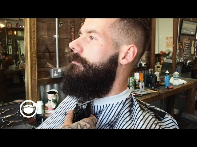 Slicked Back Army Fade with a Square Beard at the Barbershop