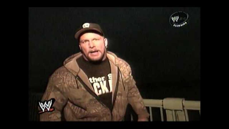 Stone Cold Chucks The Intercontinental Belt over a bridge