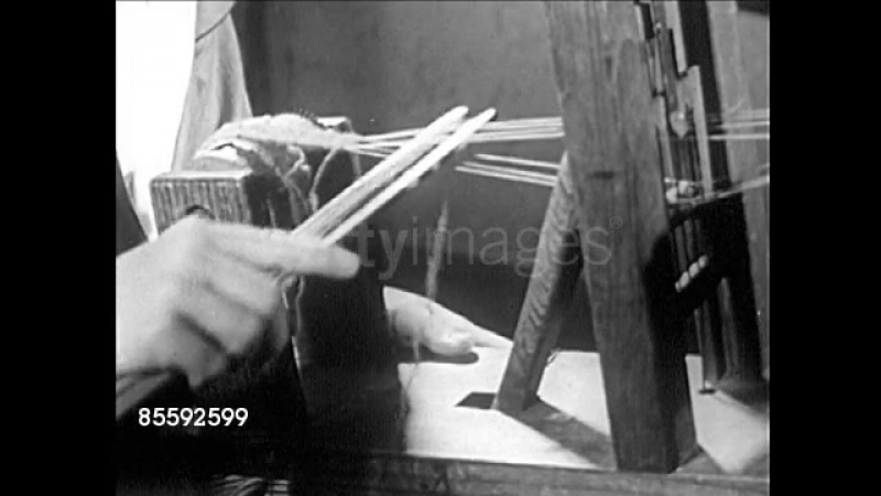 Young Girl Weaving On Small Loom