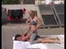 Israeli female submission wrestling on top in a roof.