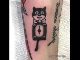 Little moving Kit-Cat Clock tattoos
