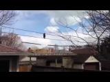 Енот-ловкач ходит по проводамRaccoon acrobat walking on some wires