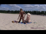 Naked Teen nudists with a snake on the beach