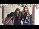 Brighton Sharbino and Saxon Sharbino play in the snow on Main Street at Sundance Film Festival in Pa