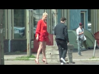 Legs for daze! Charlize Theron shows mile high pins in Berlin