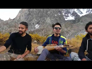 A group of youth singing a wakhi song on a pasture in Gojal Pakistan