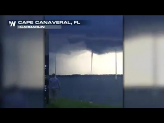 LISTEN IN: A woman in Florida reacts as a waterspout gets a little too close for comfort...