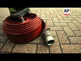 Couple turns old firehoses into fashion