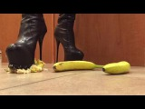 Bananas crushed to pulp by tall leather stiletto platform boots