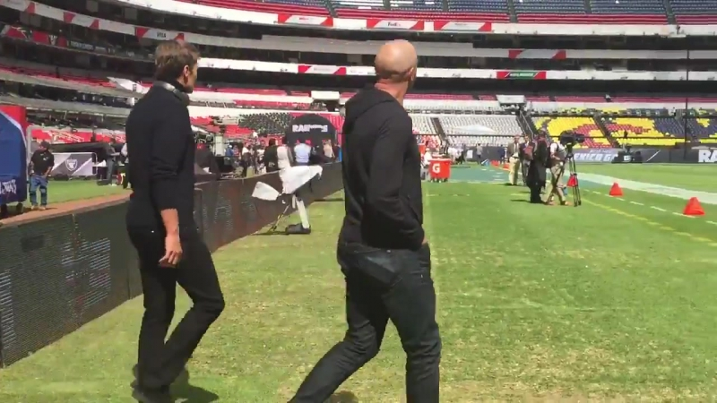 Tom Brady arrives on the field for a closer look.