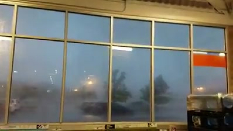 WOW An hour ago on the morning of June 24, 2017 a tornado passing front of the store in Howell, N.J. USA with sudden winds an