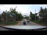 Man grabs fresh dinner off the road