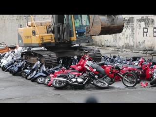 President Rodrigo Duterte witness the destruction of scooters