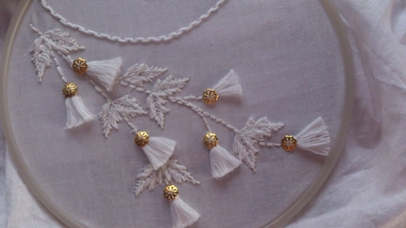 Hand embroidery. Neck line embroidery .white work. tassel embroidery .