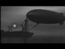 USS Akron Zeppelin Dirigible tilts and moves towards USS Patoka in the United Sta...HD Stock Footage