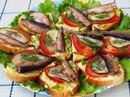 Праздничные бутерброды со шпротами