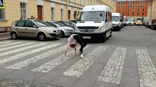 Flexible girl crosses the road
