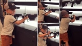 Adorable four year old boy loading and firing rifle