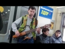 Guitar 🎸 player and singer on the electric suburban train 🚂🚃🚃 from Syzran' to Samara Evening Musiciant is singing actualit