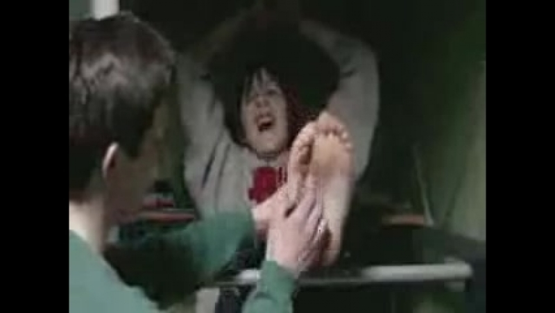 Tickling his friends barefeet