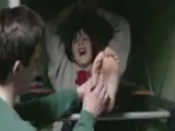 Tickling his friends barefeet