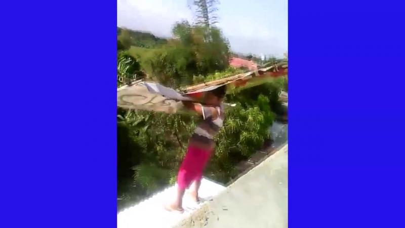 Courageous boy jump using a home-made air glider