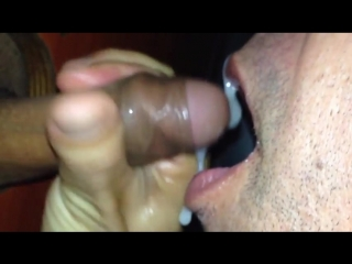 Gloryhole gay eats cock