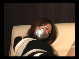 Asian babe tightly bound and tape gagged