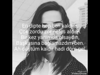 Nigar Muharrem - Omuzumda ağlayan bir sen lyrics.mp4