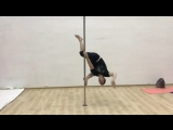 Round into split. Pole dance by Roman Masalov