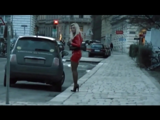Sexy blonde in red mini skirt and  tights