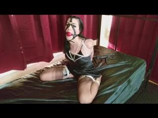 Nyxon tied up in satin bondage