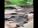 Flooding turns paved road into concrete river[1]