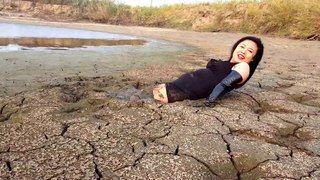 Mud boots at fishpond in China PanMian 2015 10 16