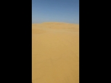 Восхождение на дюну в Астраханской пустыне.