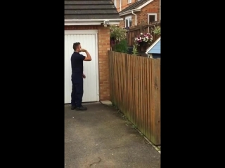 Lad plays ba neighbours dog and it passes it back