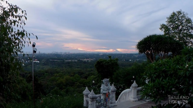 Mysterious Thai Buddha temple. Top sunset view of Pattaya from a height of 300 steps