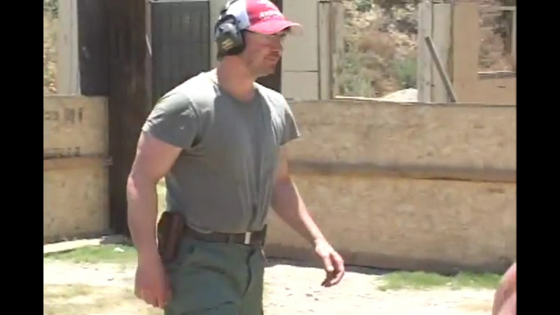 Keanu Reeves and Chris Evans undergo weapons training for their roles as cops in the film Street Kings (2008)
