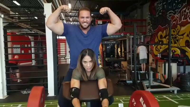 Arielle Baker lifts huge guy