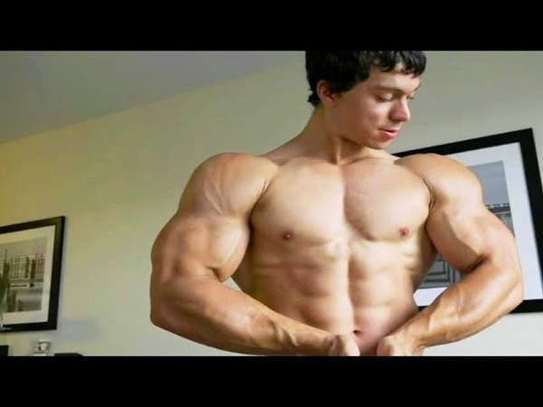 Young Massive Hunk Bodybuilder Flex Muscles