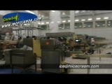 Экструзионная линия для производства эскимо мороженого с упаковочной машиной.
