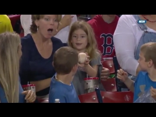 Smooth kid gives foul ball to pretty girl sitting behind him.