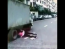 She nearly gets completely crushed by a lorry. Holy sh*t! 😱😱