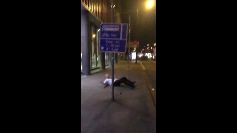 Lad jumps and headbutts a road sign