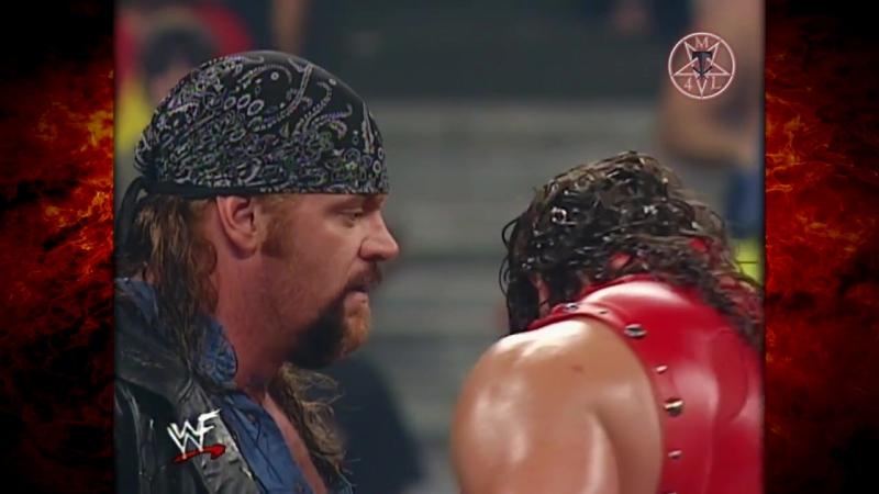 Kane Destroys Busts Open An Injured Undertaker 08.17.2000