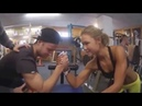 Arm wrestling mixed Beautiful woman vs weak man at gym